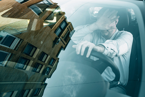 istock Surprised driver in the car. Car accident. Abrupt steering. 1134004074