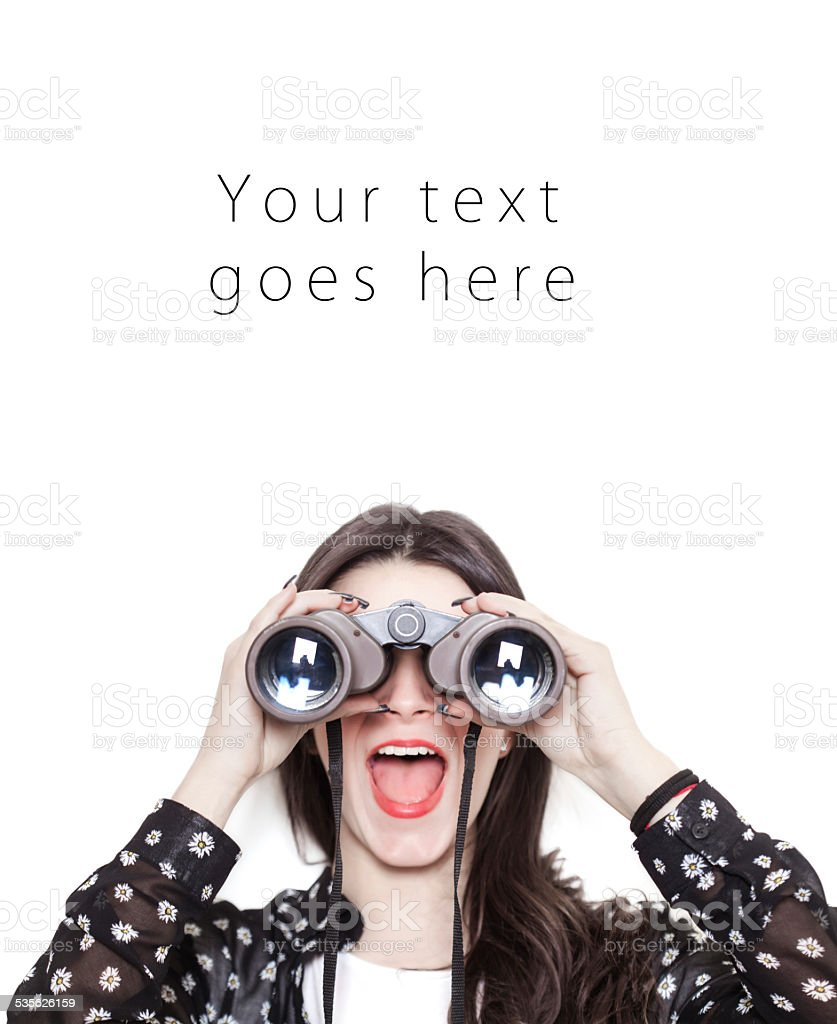 Surprised girl looking through binoculars card stock photo