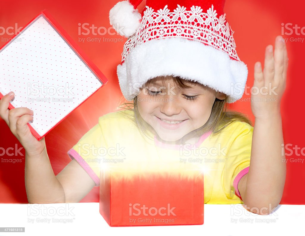 Surprised girl opening a gift royalty-free stock photo