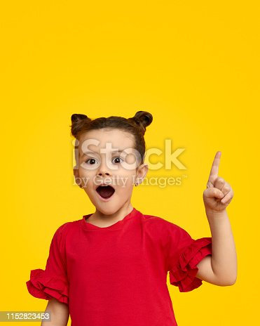 istock Surprised girl pointing up 1152823453