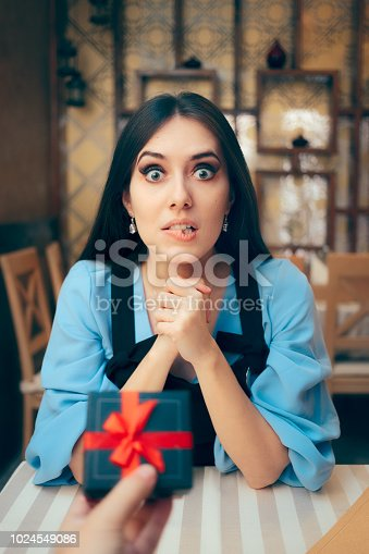 Husband offering a present to his wife celebrating relationship