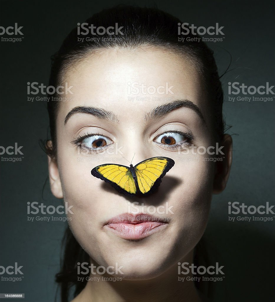 Surprised girl with a butterfly on her nose royalty-free stock photo