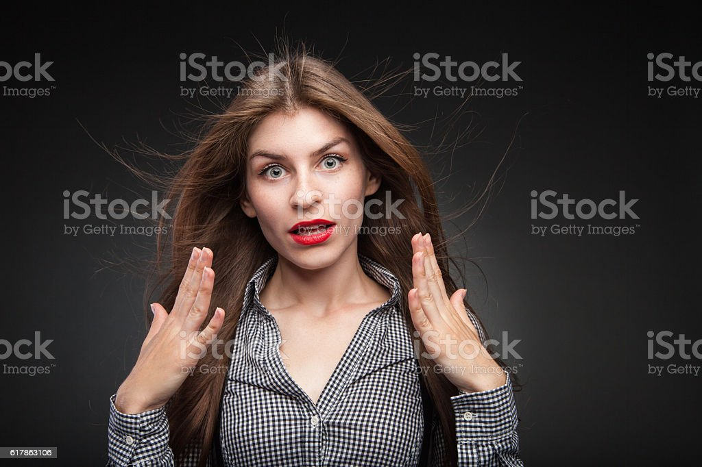 Surprised girl with wide opened eyes. stock photo