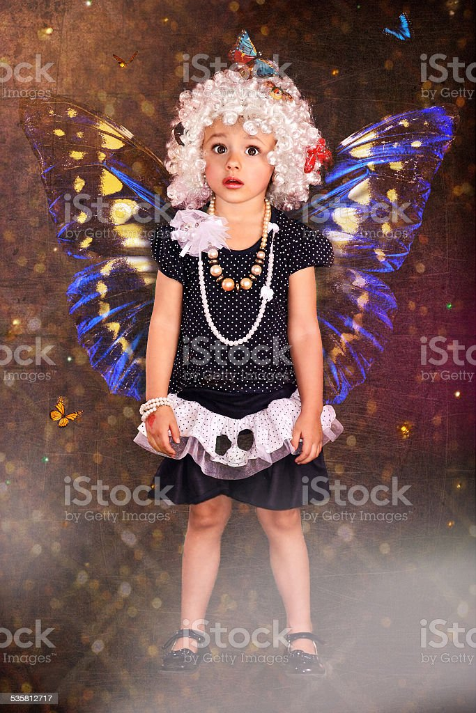 Surprised girl-butterfly stock photo