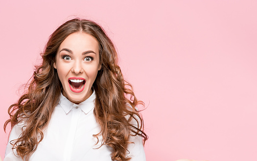 istock Surprised happy beautiful woman looking in excitement 939043084