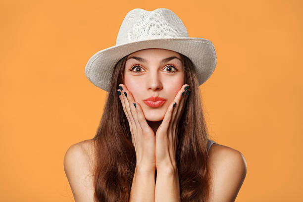 surprised happy beautiful woman looking sideways in excitement. excited girl - preppy fashion stock photos and pictures