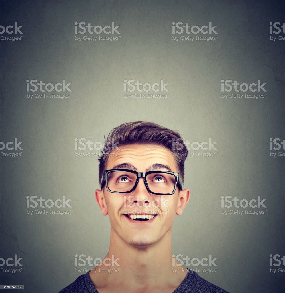Surprised happy man wearing glasses looking up royalty-free stock photo
