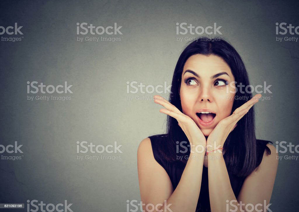 Surprised happy woman looking sideways in excitement. stock photo