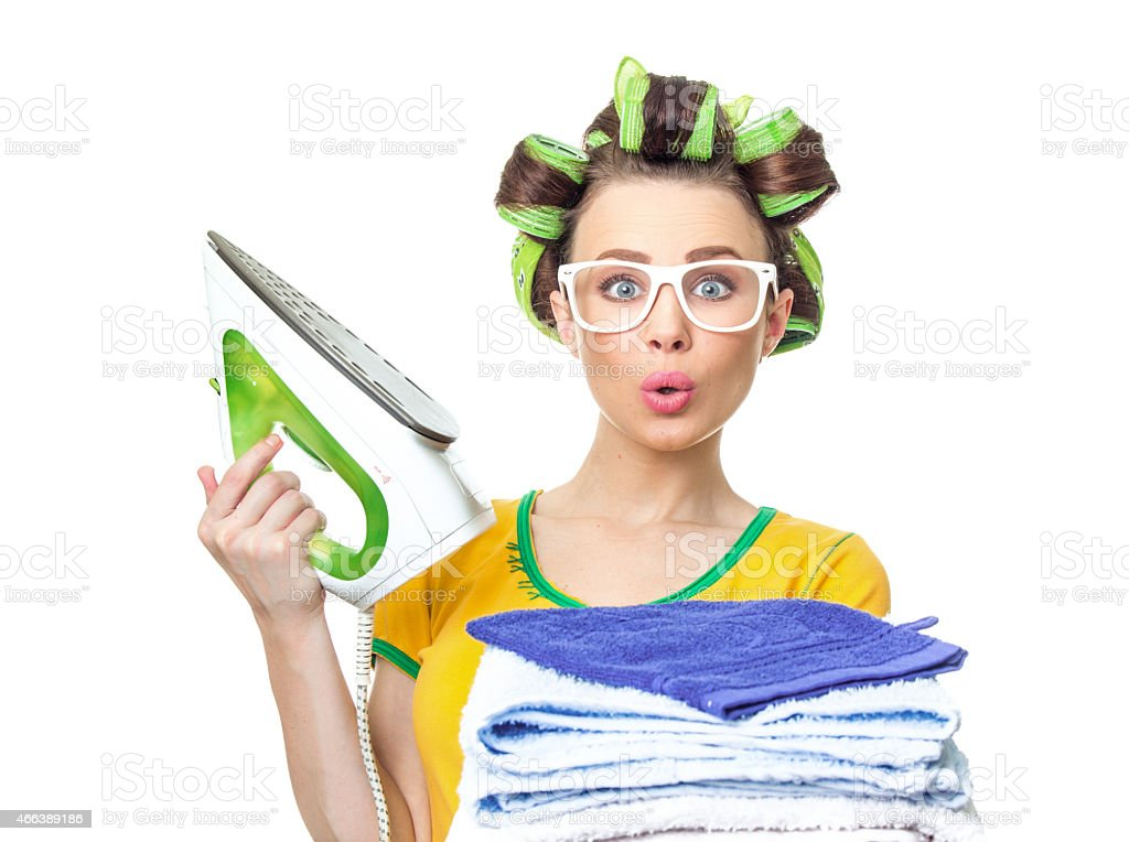 Surprised housewife with iron stock photo