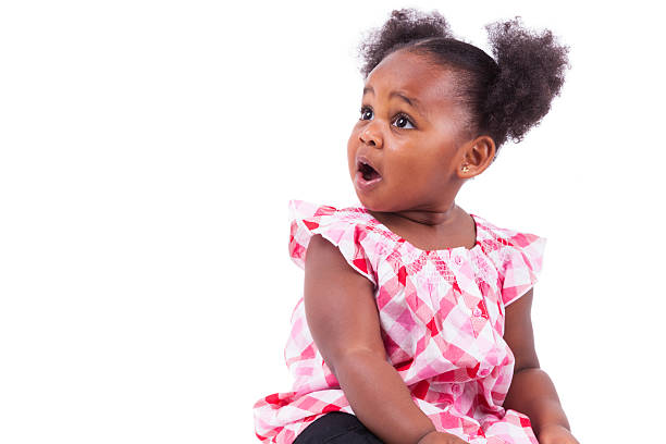 Surprised little african american girl stock photo