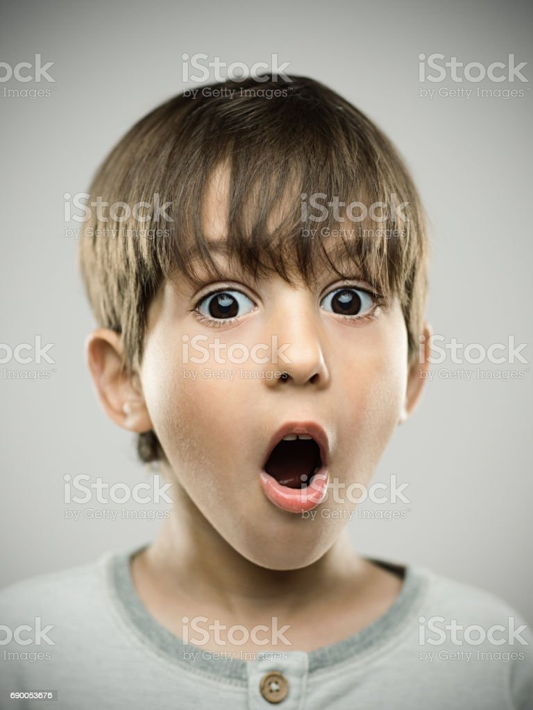 Surprised little boy with mouth open stock photo
