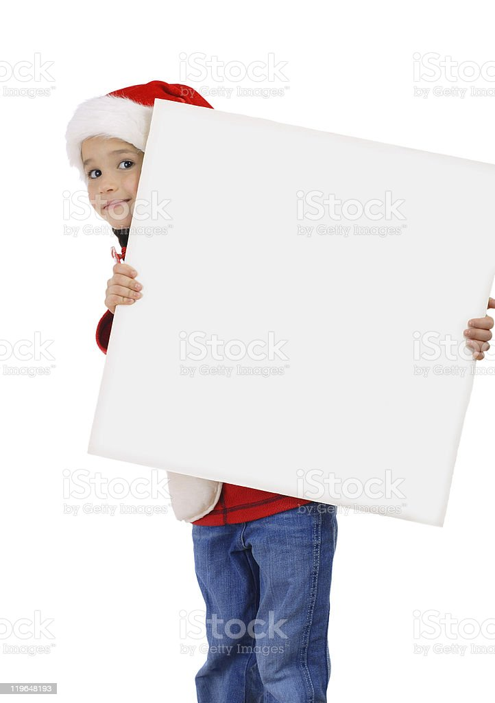 Surprised little girl in Christmas hat with an empty banner royalty-free stock photo