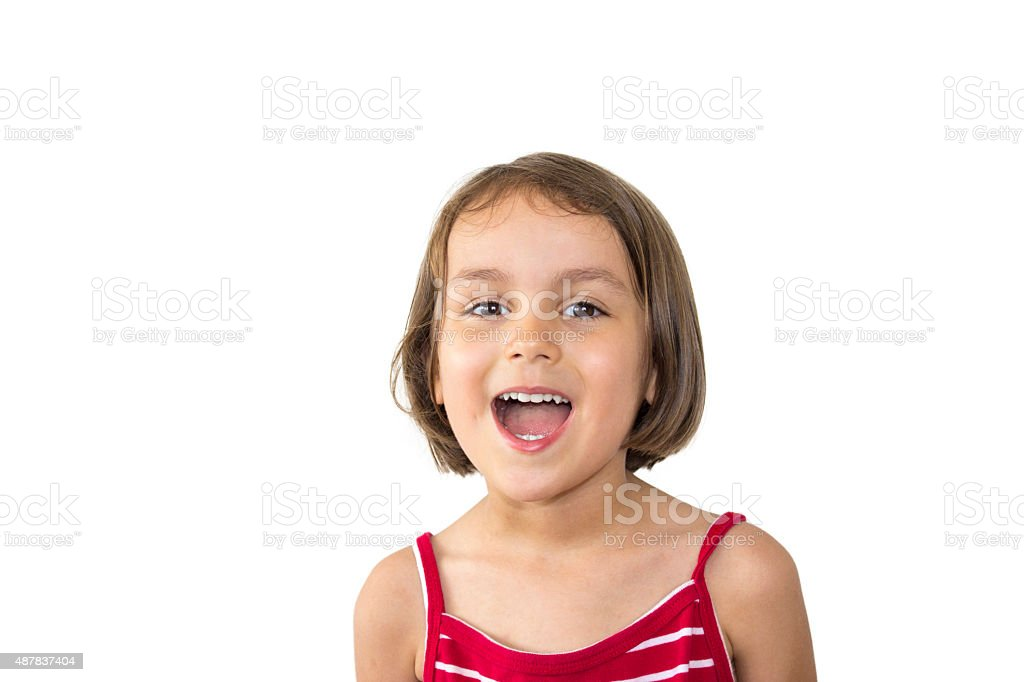 Surprised little girl looking at camera in excitement stock photo