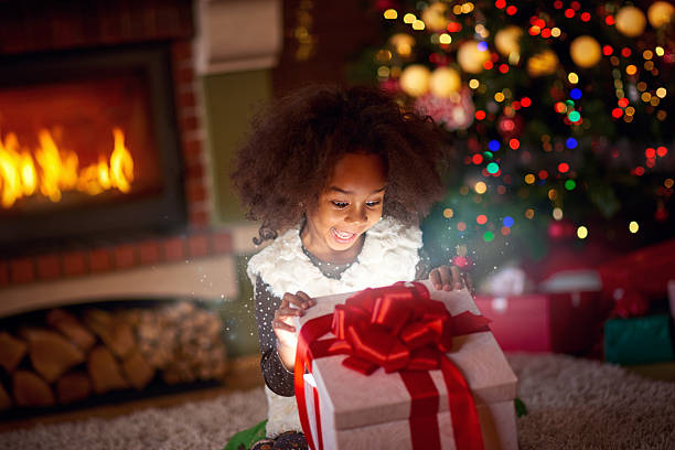 Surprised little girl looking in magic gift stock photo