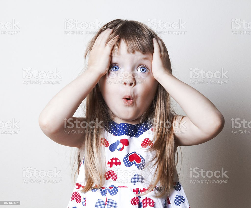 Surprised little girl stock photo