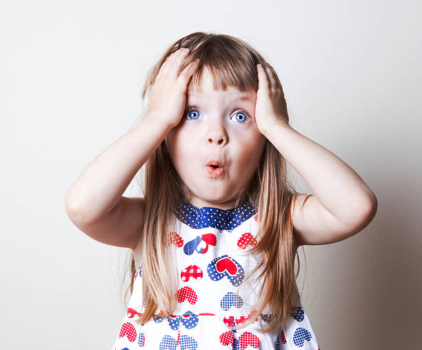surprised little girl - astonishment stock photos and pictures