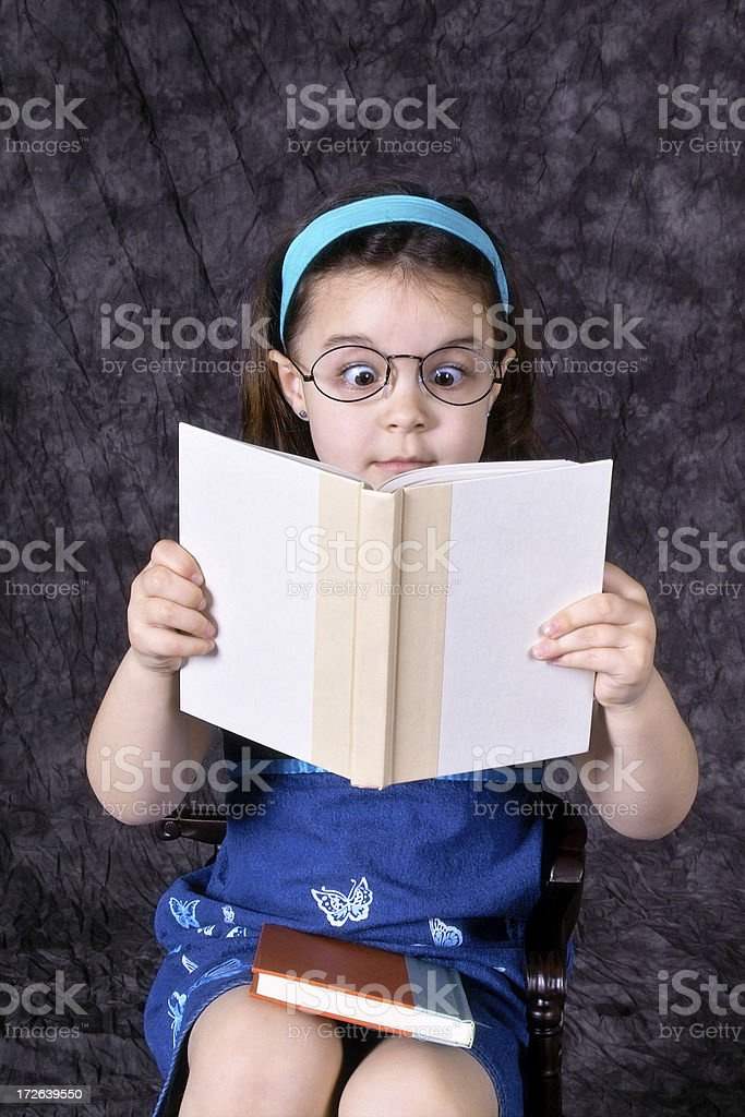 Surprised Little Girl Reading Book royalty-free stock photo