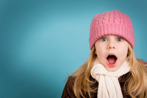 Surprised Little Girl Wearing Knit Hat, With Copy Space