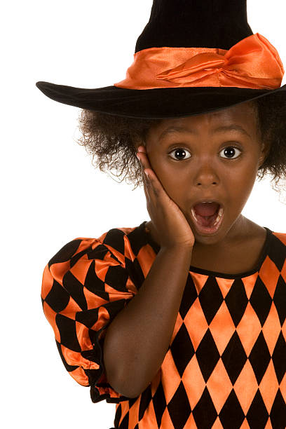 Surprised little witch stock photo