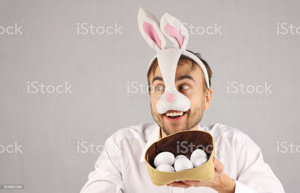 surprised man in the mask Easter rabbit looking to the side stock photo
