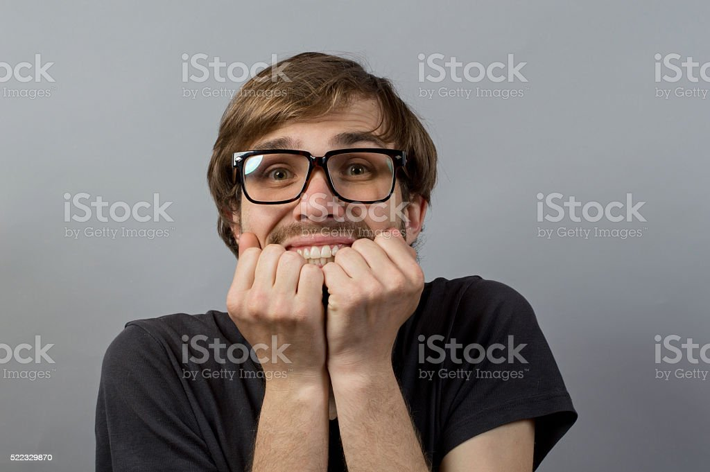 Surprised man on gray background stock photo