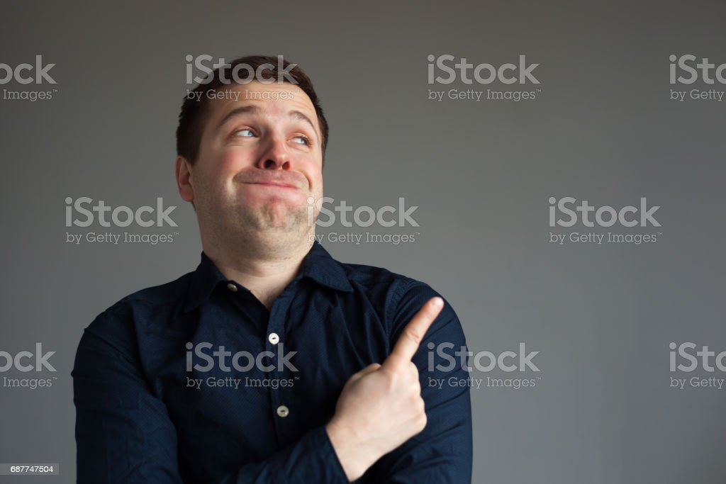 Surprised man showing on important information stock photo