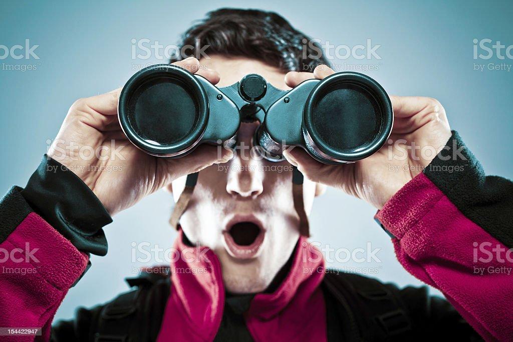 Surprised man with binoculars royalty-free stock photo