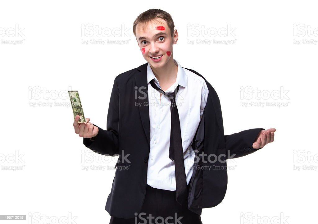Surprised man with dollars in kisses stock photo