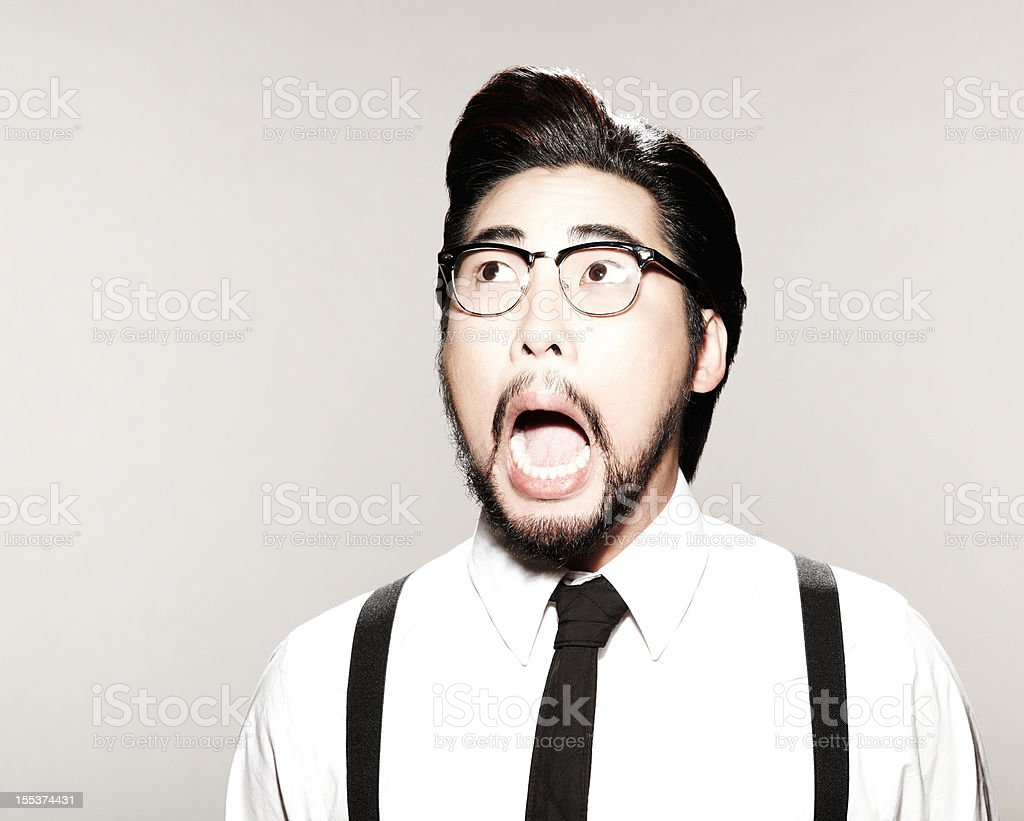 Surprised Man With Suspenders, Tie, and Glasses stock photo