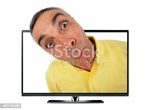 istock Surprised man with television and WOW expression. 482285385