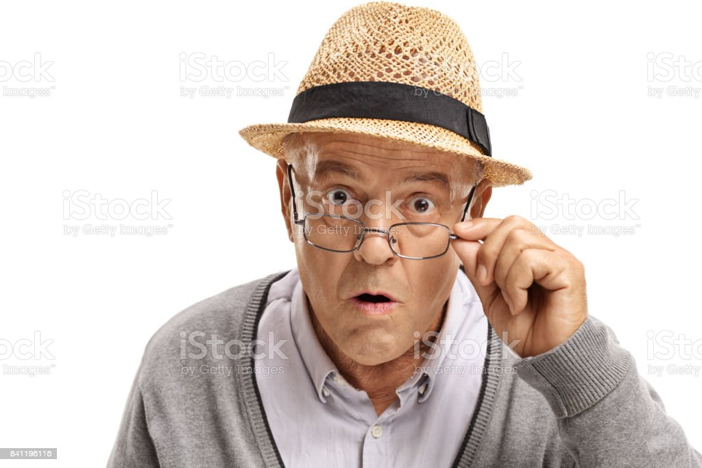 Surprised mature man looking at the camera stock photo