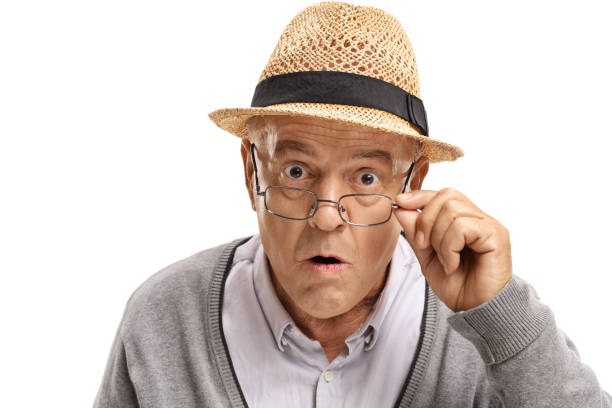 Surprised mature man looking at the camera Surprised mature man looking at the camera isolated on white background one senior man only stock pictures, royalty-free photos & images
