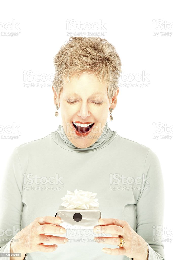 Surprised mature woman receiving a gift royalty-free stock photo