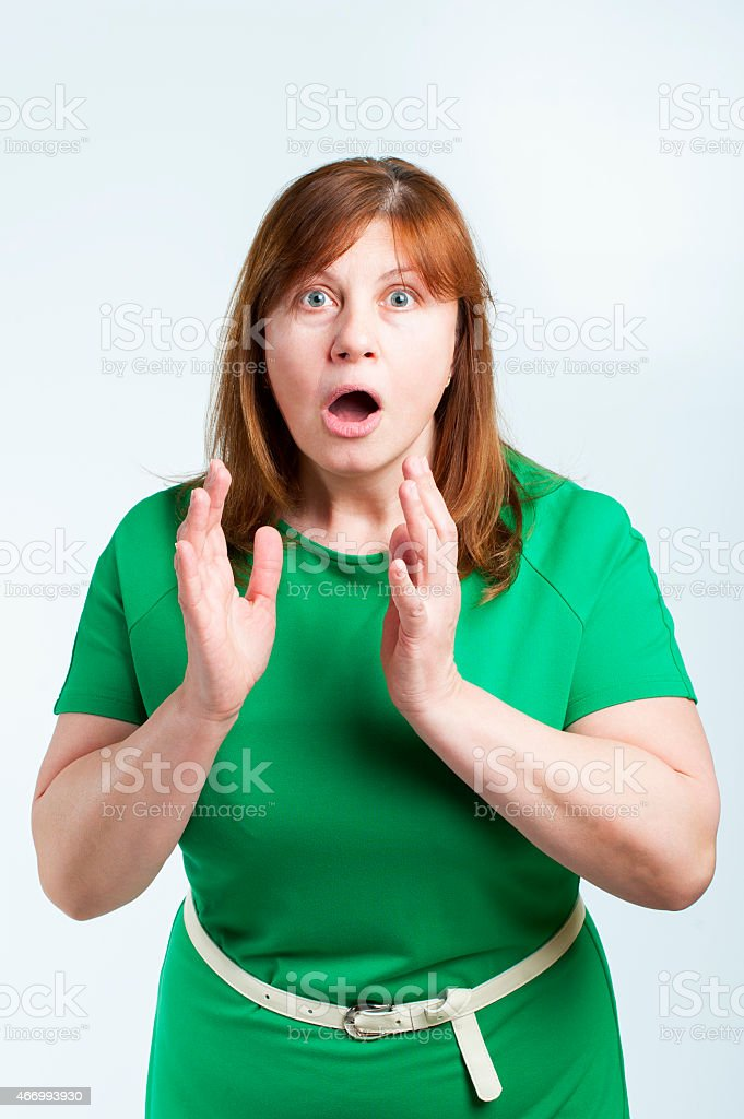 Surprised middle-aged woman.. stock photo