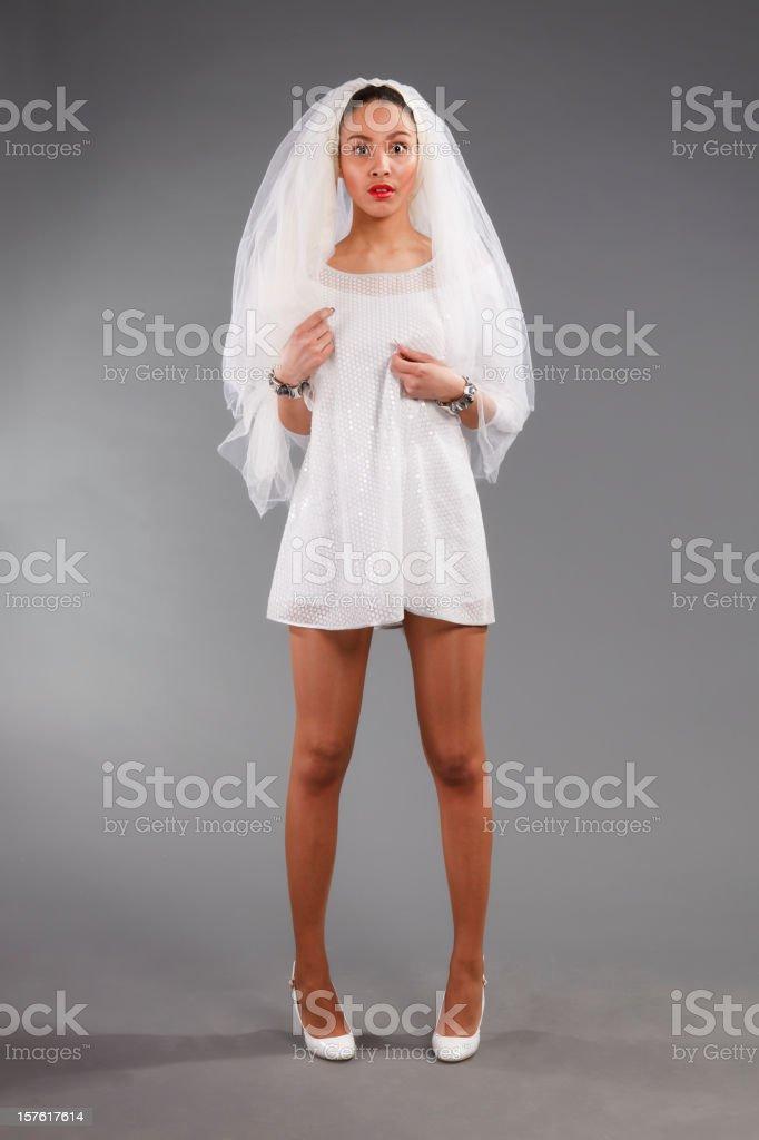 Surprised Mulatto bride in white dress royalty-free stock photo