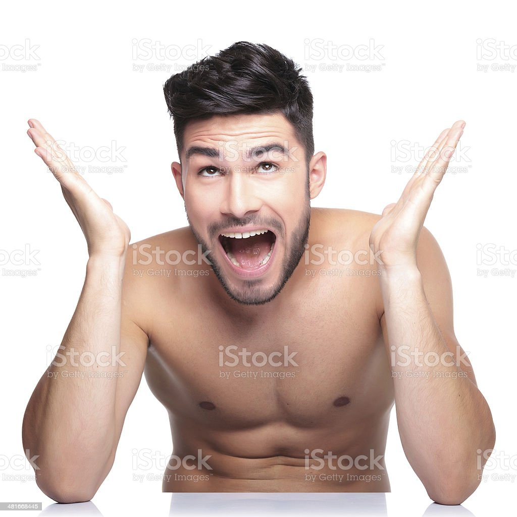 surprised naked man looking up - Royalty-free Adult Stock Photo