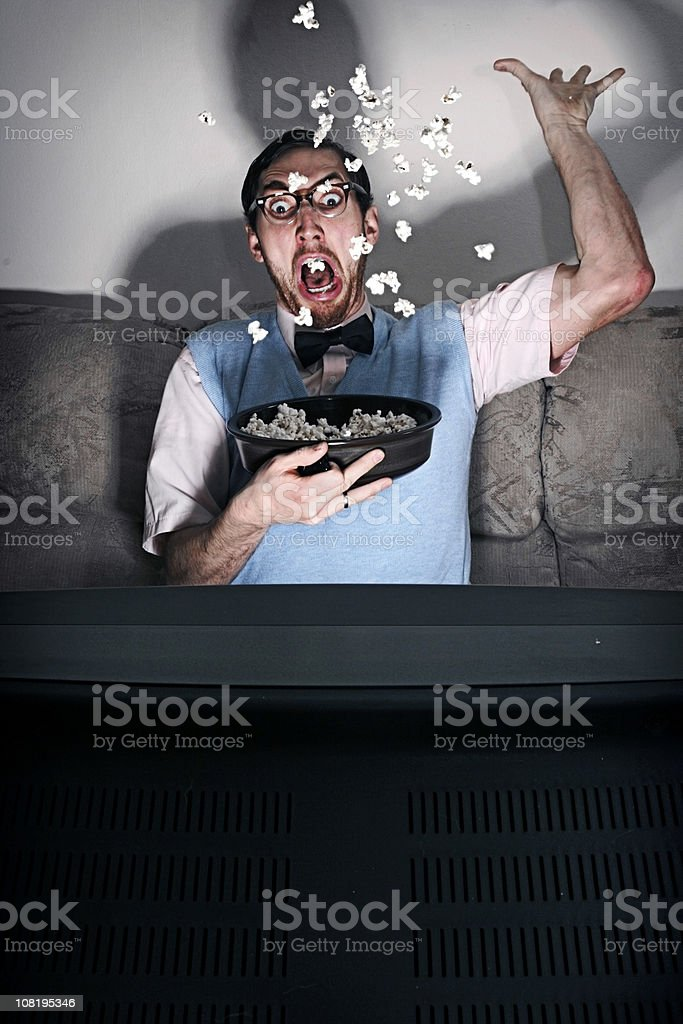Surprised Nerd Watching A Scary Movie royalty-free stock photo