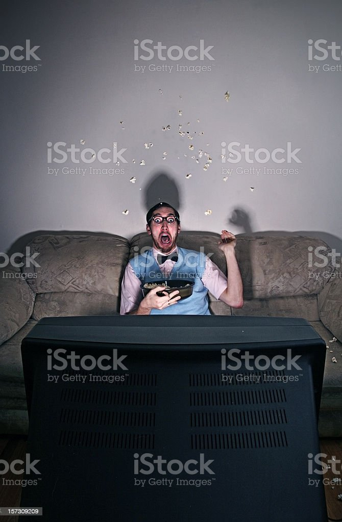 Surprised Nerd Watching A Scary Movie stock photo