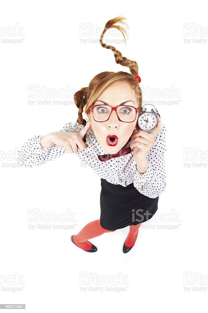 Surprised Nerdy businesswoman holdin small clock royalty-free stock photo