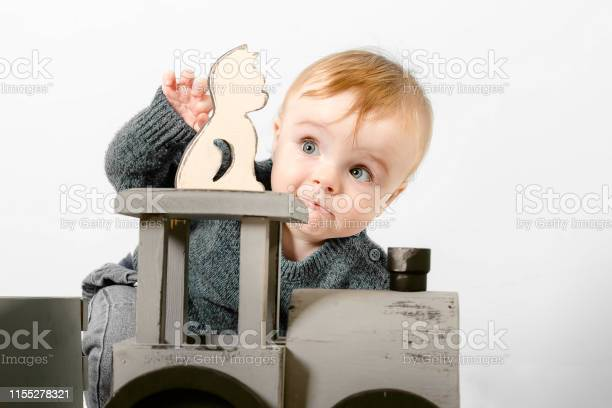 Surprised one year old child in a gray sweater plays wooden toys picture id1155278321?b=1&k=6&m=1155278321&s=612x612&h=typrzo7cbapm 60bazzkohmt8snhsivach8 w 0wqi0=