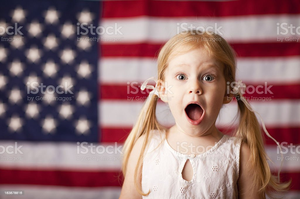 Surprised or Excited Little Girl with American Flag royalty-free stock photo