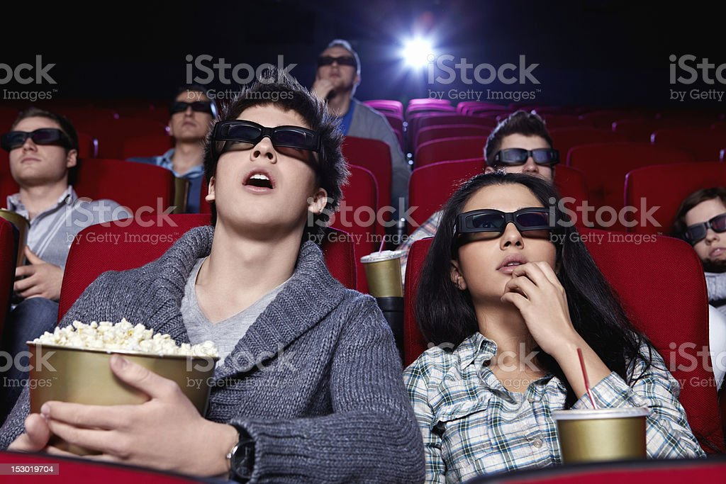 Surprised people are watching a movie stock photo