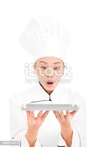 istock surprised pretty  woman chef looking tray 490315315