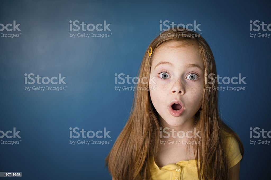 Surprised, Red-Headed Little Girl, With Copy Space royalty-free stock photo