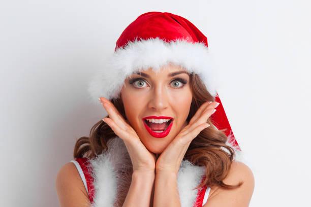Surprised Santa girl stock photo