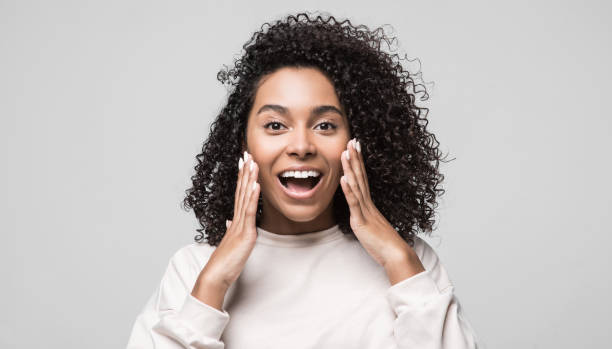 Surprised shocked young woman portrait stock photo