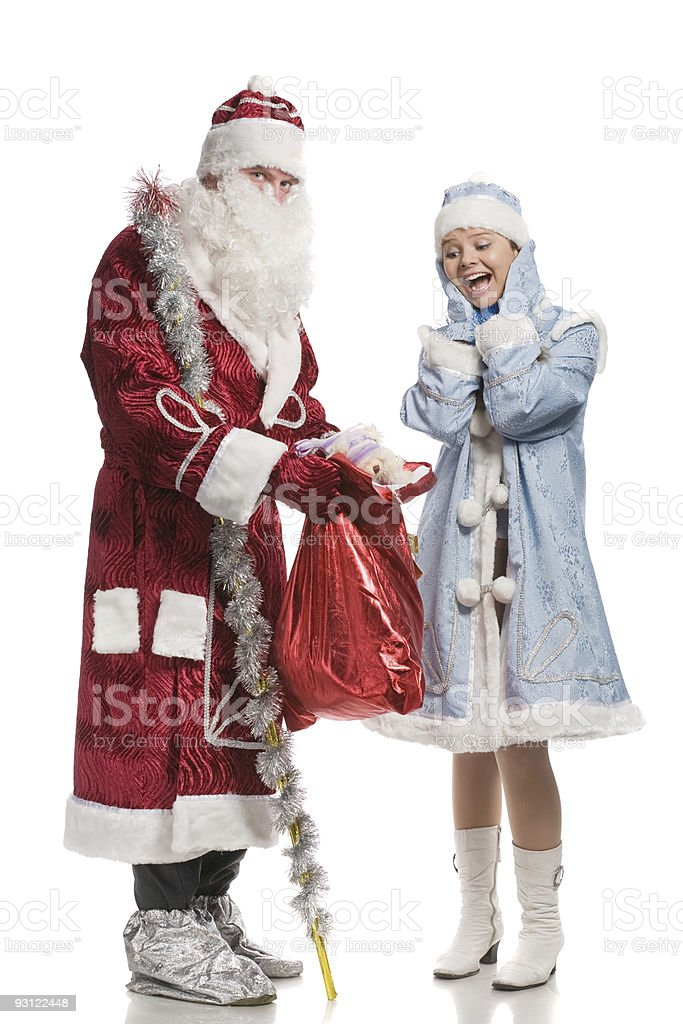 Surprised snow maiden and Santa Claus royalty-free stock photo