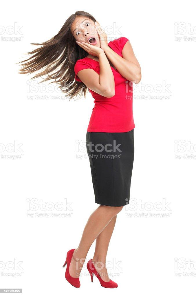 Sorpresa donna in piedi sul bianco foto stock royalty-free