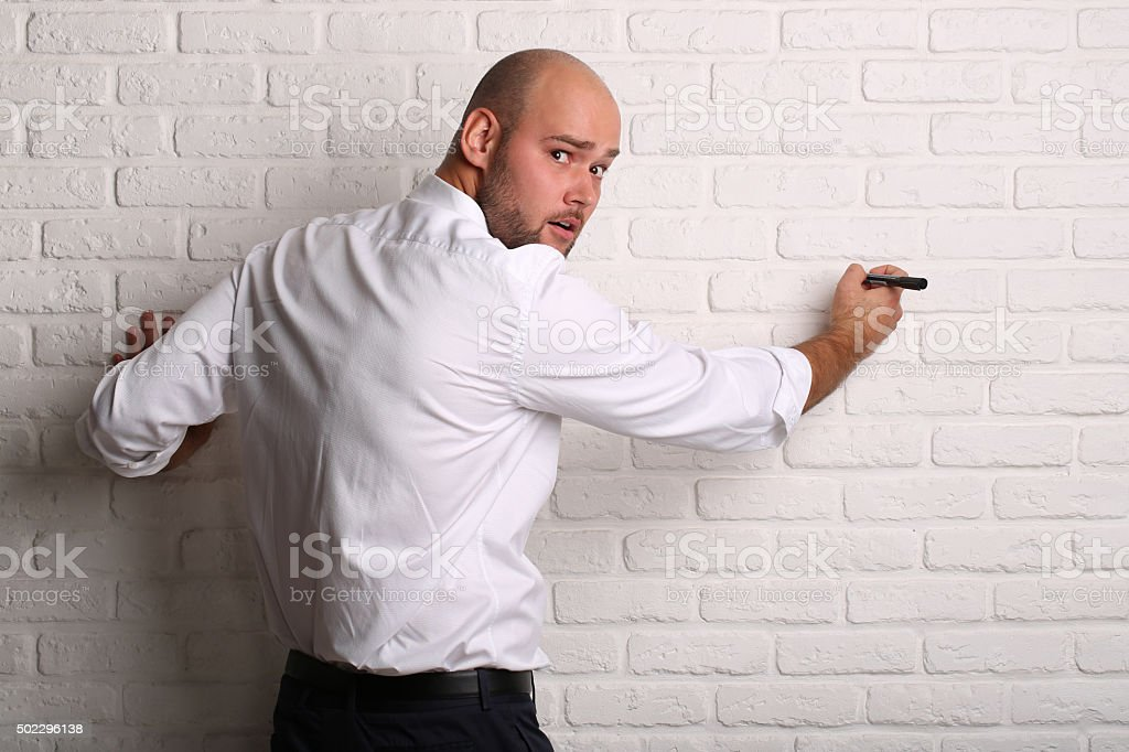 Surprised stylish and brutal bald man with a beard stock photo