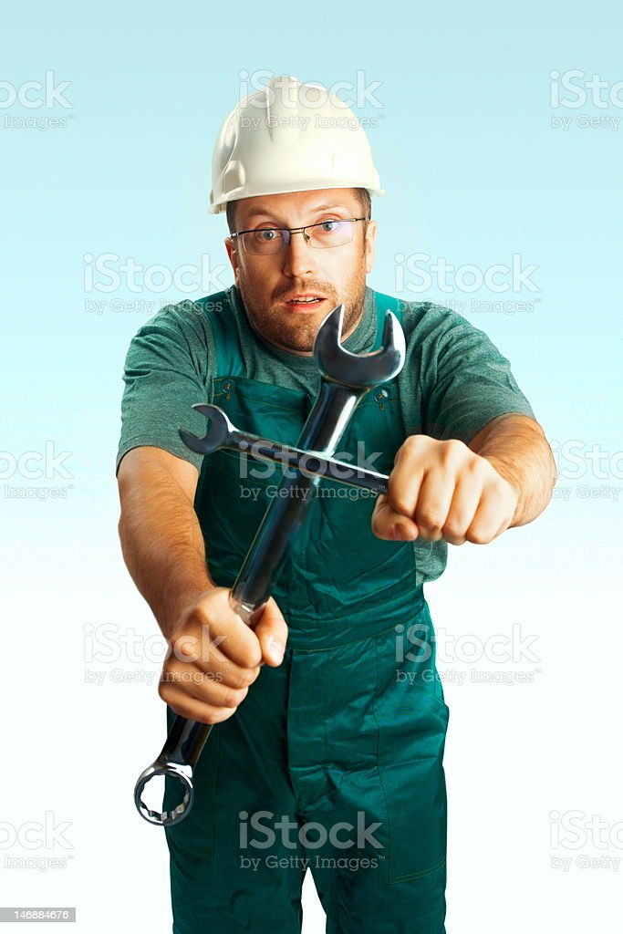 Surprised superstitious workman with cross royalty-free stock photo